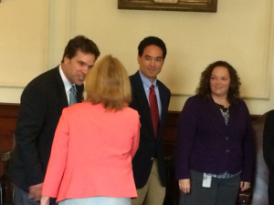 Steve Langa shakes Governor Hassan's hand at New Hampshire bill-signing ceremony
